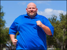 An obese man running